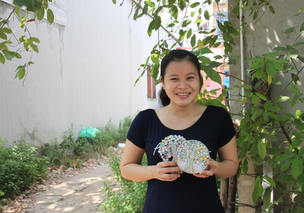 "In Vietnam: Tran Thi Kha earns nearly three times her previous salary as a receptionist creating paper art with our fair trade partner Mai Handicrafts. ""I love this work because it's beautiful,"" she says."