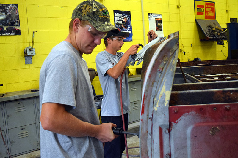 Beaverton Juniors Jacob Uhl and Wyatt Grove are gaining a variety of skills and experience in CTE's Auto Tech class, including body work.