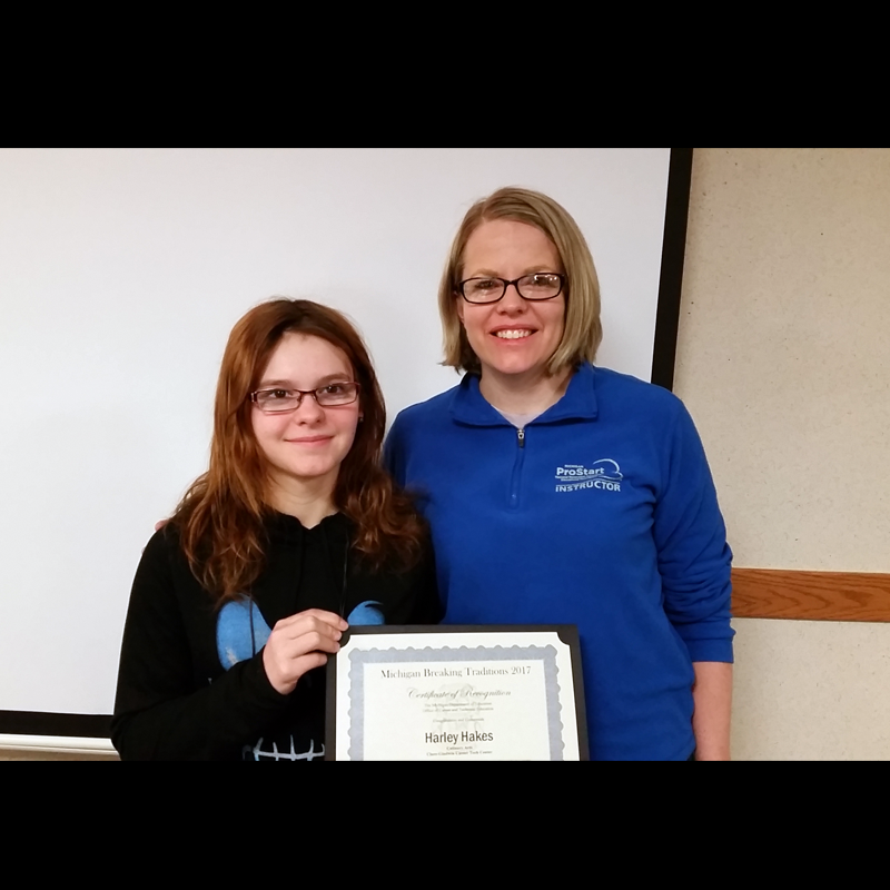 Harrison senior Harley Hakes, left, received the Michigan 2017 Breaking Traditions Award for her accomplishments in a nontraditional CTE program. Pictured with Hakes is her instructor, Heidi Rocha.
