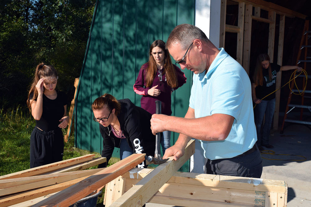 Wood's experience as an Industrial Arts teacher in Harrison comes in handy as he and his students work on the barn.