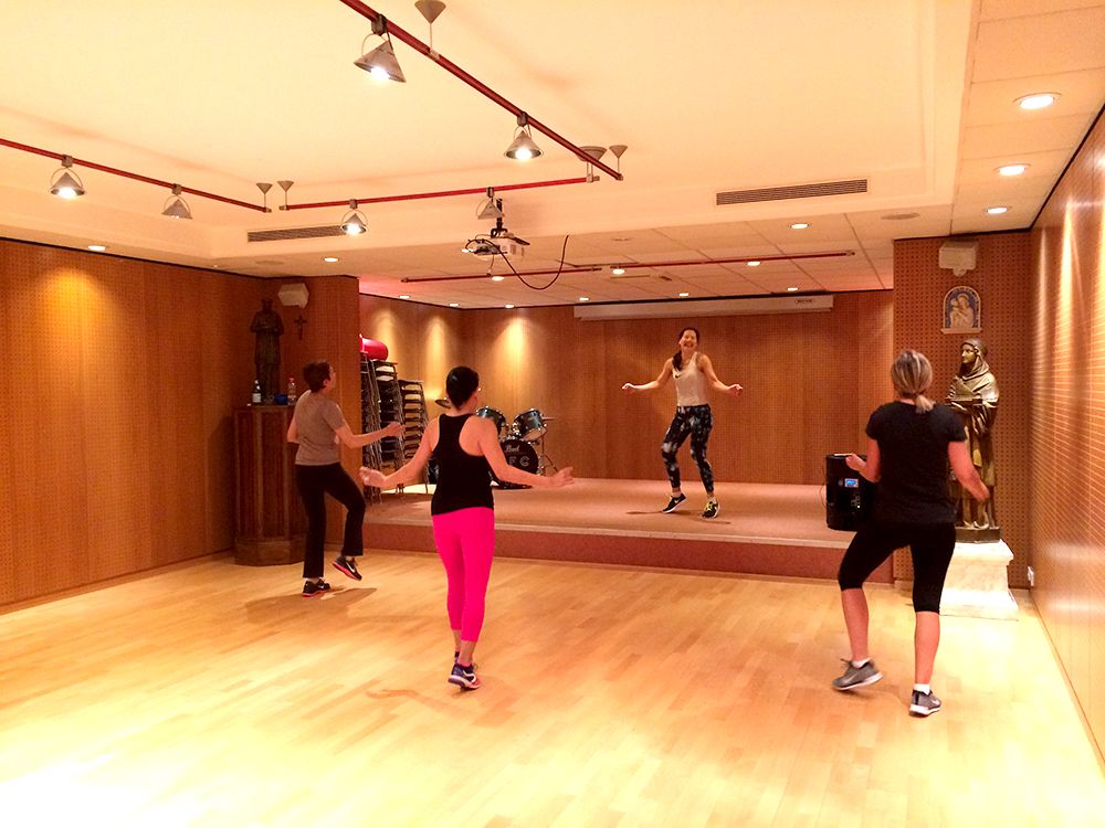 Zumba in the basement of a local Monaco church. Photo by Katie Askew
