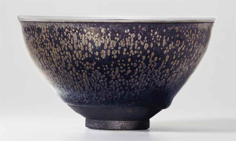 "The Kuroda Family Yuteki Tenmoku, a very rare ""oil spot"" Jian ware tea bowl, Southern Song dynasty (1127-1279),US$ 11,701,000.00 at Christie's lot 707, September 15, 2016, New York"