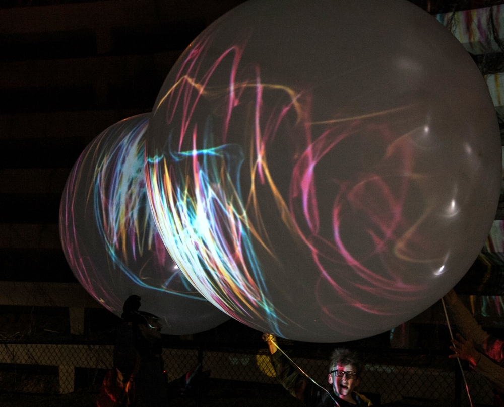 """Walk with Light"" on the 606 - collaborative moving light drawings with illuminated balloons by FieldWork. Photos courtesy of FieldWork."