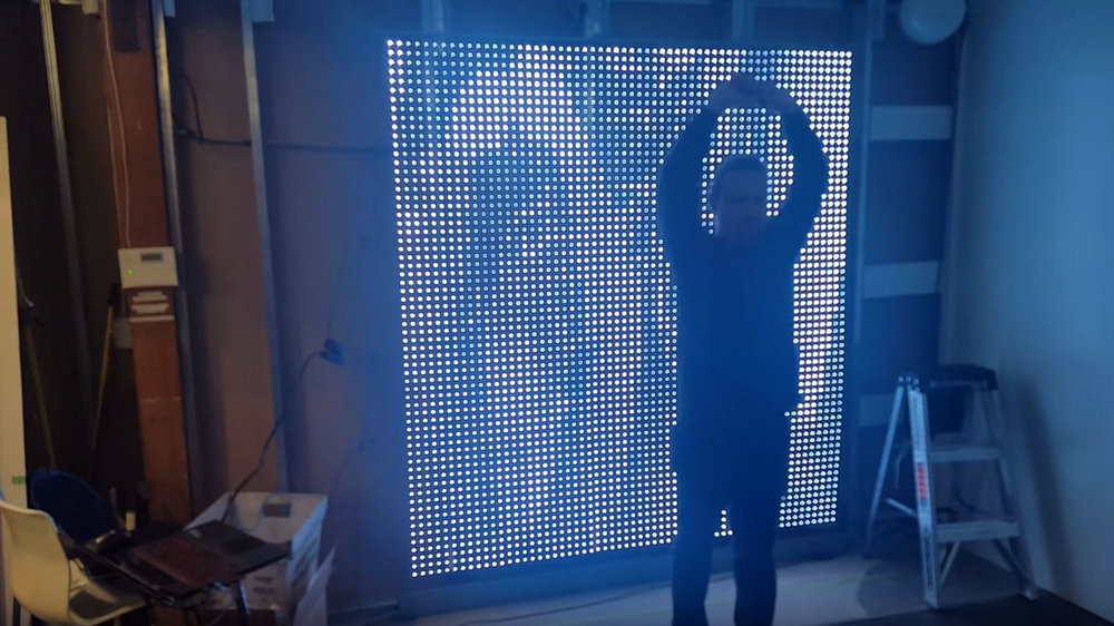 Large-Format LED Wall - The display features LED pixels spaced far apart so that you can see inside the storefront as well as the displayed image.