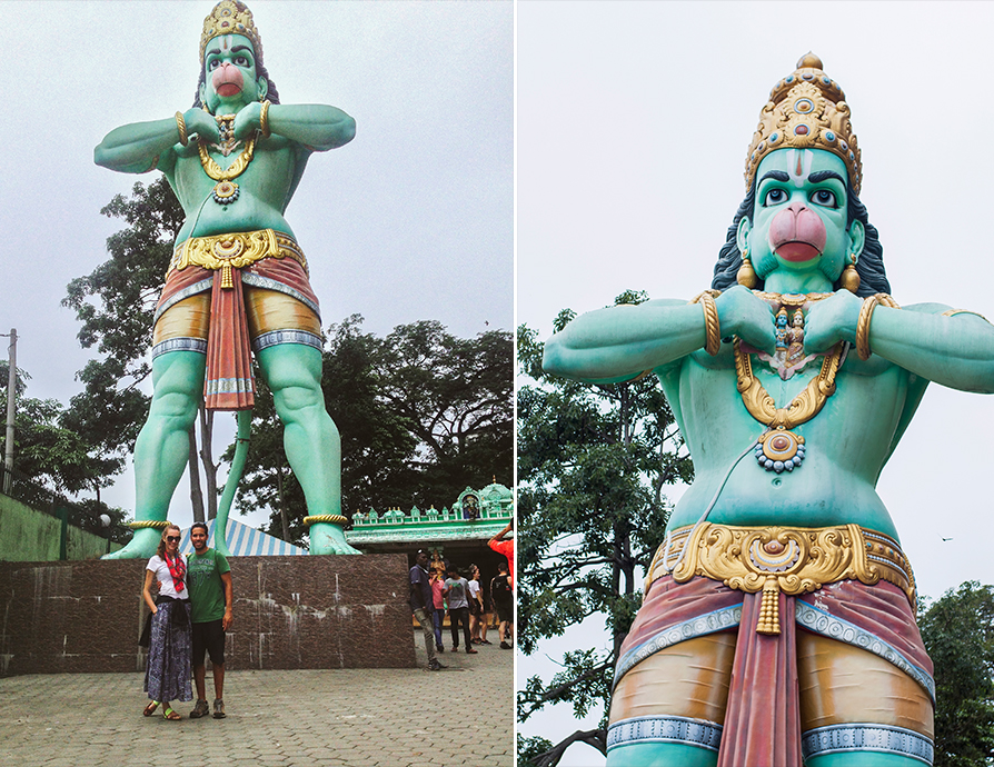 A STATUE OF HANUMAN STOOD TALL AS WE ENTERED  BATU CAVES .