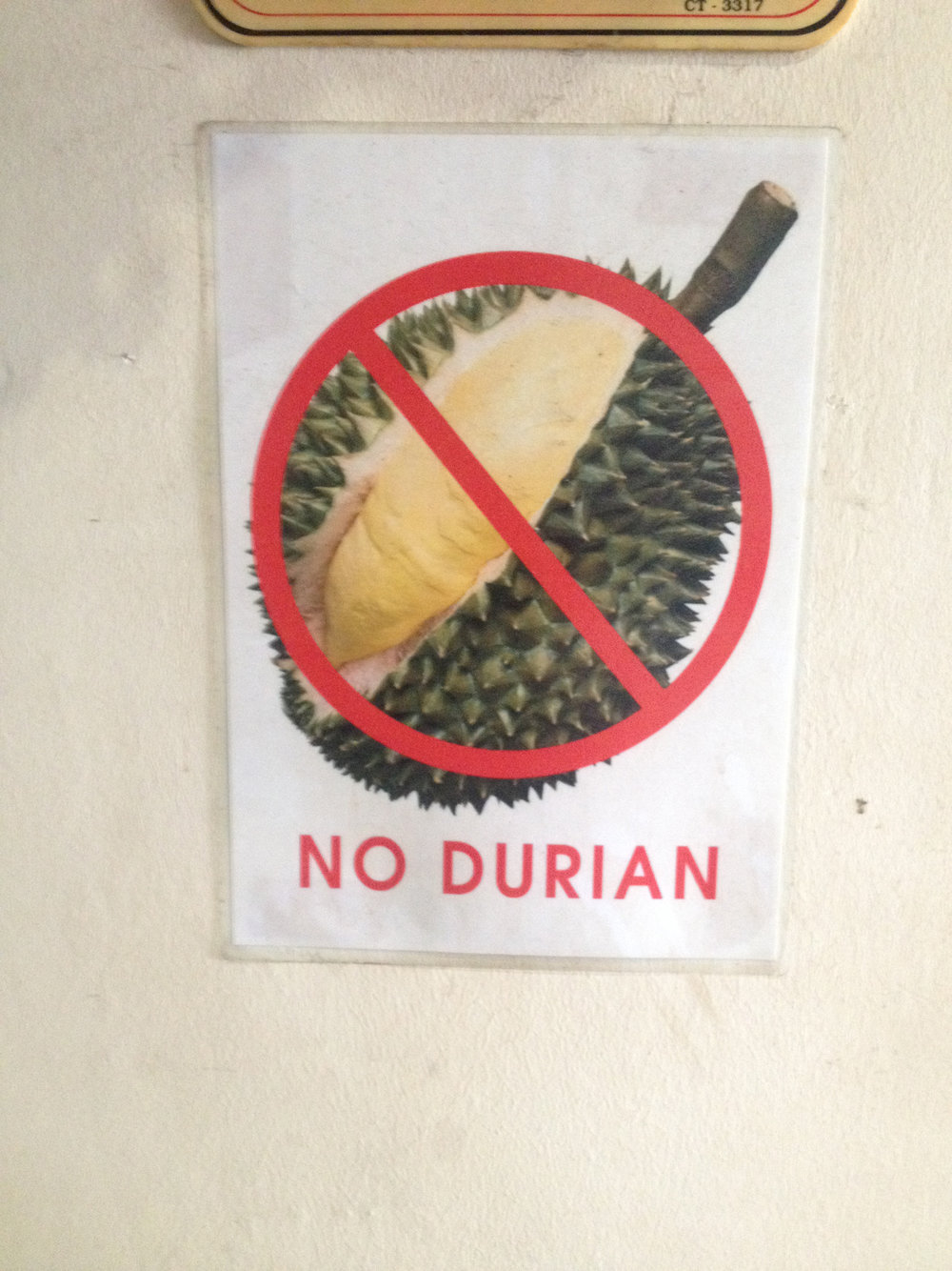 DURIAN IS A FAVORED FRUIT IN MALAYSIA, BUT SMELLS LIKE ROTTING GARBAGE...LITERALLY SO THESE SIGNS WERE POPULAR IN BUSINESS AND TRANSPORTATION.
