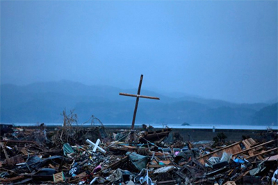 Amid the tsunami devastation in northern Japan, a wooden   cross stands     where there was once a church               [Yasuyoshi Chiba / AFP/Getty Images]