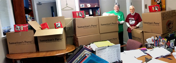 Some of the 600 shoe boxes collected in the highlands, with brenda watson and chief coordinator, kathy burk