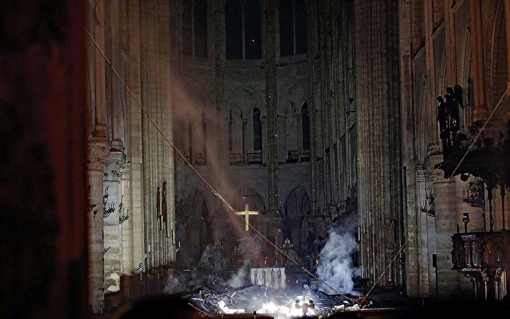 HOPE cross stands pure and clear amid the ruins of Notre Dame in Paris better lo res.jpg