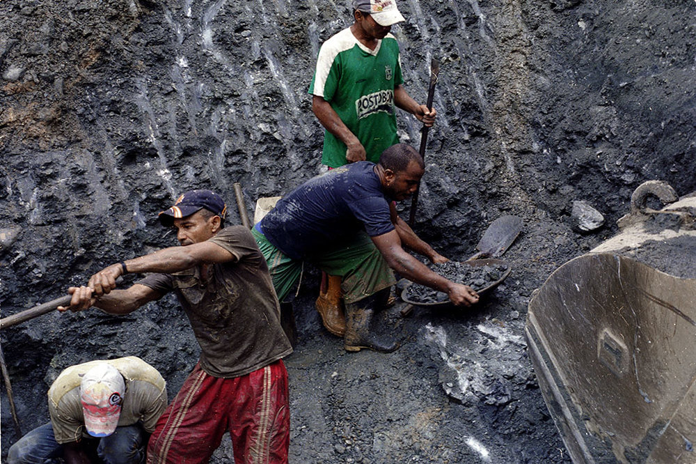 At a gold mine on the outskirts of Zaragoza, Antioquia, Colombia, in the region known as La Puercera, approximately 150 freelance gold miners pan for gold in a pit dug by the company which operates this gold mine.