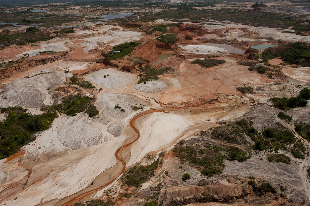 View of gold mining zone in northern Antioquia department, as seen from police helicopter.  Many miners use mercury, a harmful neurotoxin, to separate gold particles from the surrounding soil, both in river-based and underground mining. The run-off of mercury introduces dangerous levels of this liquid metal into rivers, springs, and underground aquifers.