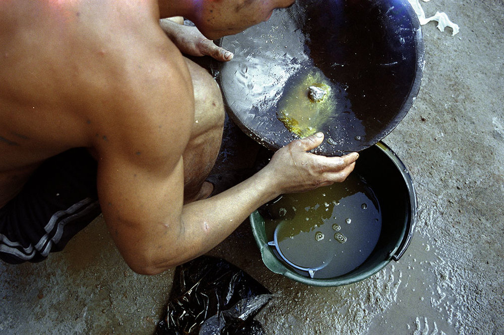 Miner uses mercury to separate gold in Segovia, Antioquia.