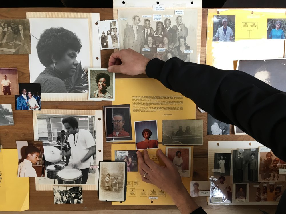 Magnum Foundation fellow Christian Padron works with his family archive in a project describing the Afro-Cuban American experience in New York. Photo by Liz Sanders.