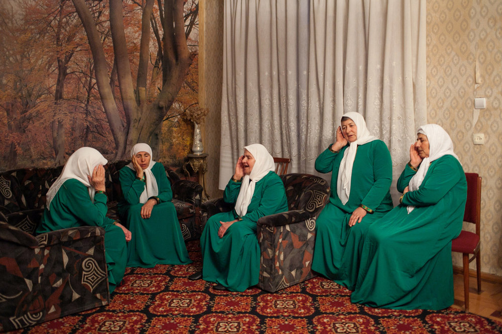 "Tako Robakidze. Folk ensemble ""Daimokhkan Aaznash"" (Chechnyan for ""Native Tunes""), established by 76-year-old Makvala (Badi) Margoshvili. Women chanting – Nazmi for peace in Georgia and the world. Duisi Village. Pankisi Gorge. Georgia. 2015"