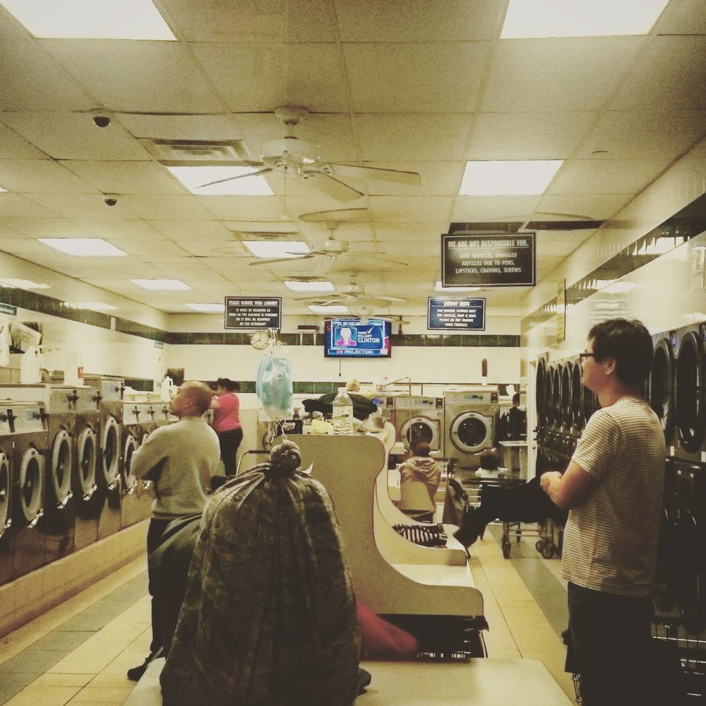 November 8, 2016, at a laundromat in #Queens, #NewYork, people are watching TV while the election results come in. The US immigration policy would radically turn to be restrictive and repressive in the case of a #Trump victory. Photo by @nadege_mazars.