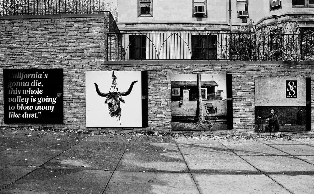 Installation of Matt Black's The Geography of Poverty along 110th Street, photo by Jasper Briggs.