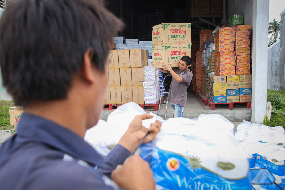 Tran Mau Duc back at work following his heart transplant. © Tran Quoc Ahn