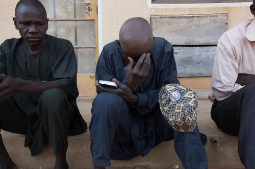 A man prays during Sunday service at the Damare IDP camp. The service provides a space for traumatised IDPs to begin the healing process by giving them strength through sermons and testimonies of survival, says John Nihanpa the camps pastor. 2014, © Rahima Gambo