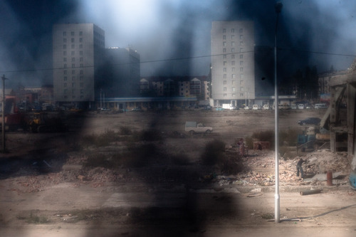 The demolition of Grozny's old market, which was a meeting point for locals before and during two wars in Chechnya, but did not survive the city's reconstruction. Grozny, Chechnya, Russia, October 2009