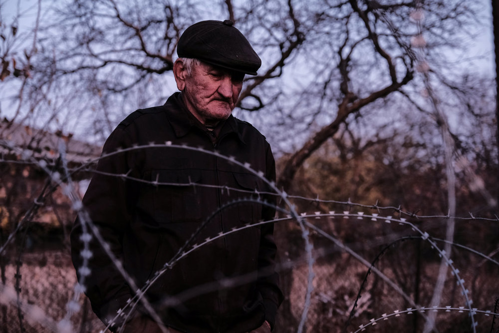 One day, Data Vanishvili found his house on occupied territory, where he lives now in poverty. He is not allowed to cross the fence and has no access to his pension. Village of Bobnevi, 2017.