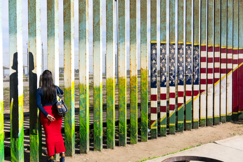 Nick Oza. Women looking through the fence in Tijuana, Mexico, talking to a family member on the U.S. side, September 22, 2017.