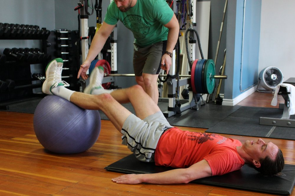 Breathe Fintess personal trainer Len Panchuk training male client