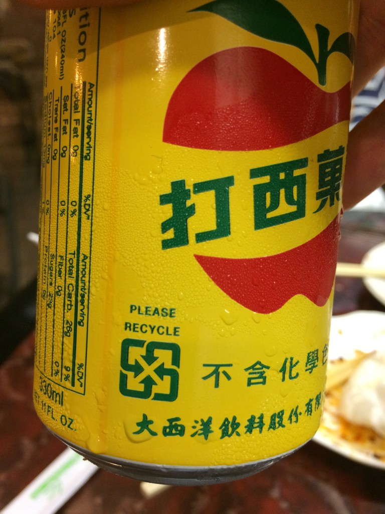 Can of apple soda with Taiwanese recycling symbol