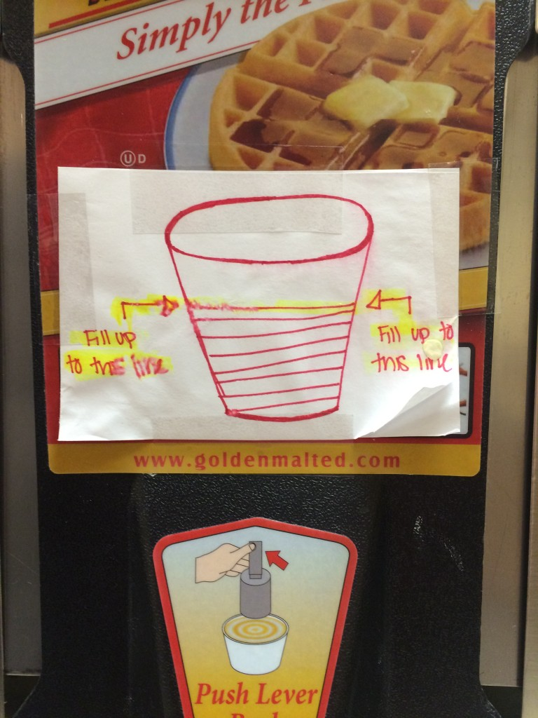 Waffle batter dispenser with hand drawn sign showing fill level