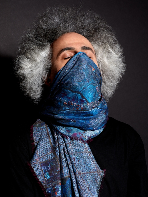 Mohsen Namjoo, artist, singer/song writer, composer from Mashhad, wearing the Mashhad scarf
