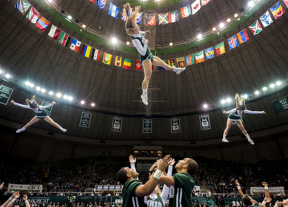 The Ohio University cheerleading team performs for over 11,000 Bobcat fans during halftime of the men's basketball game against Akron at the Convocation Center, on Feb. 28, 2013, in Athens, Ohio.