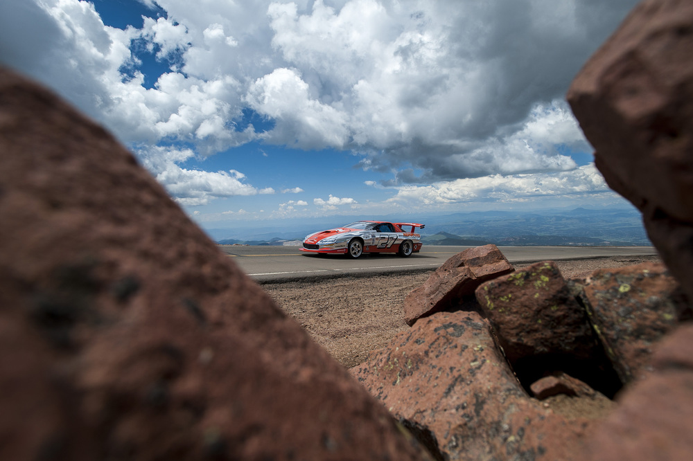 Cars of all types race to the top of Pikes Peak during The Broadmoor Pikes Peak International Hill Climb at the summit on Saturday, June 28, 2015. Due to thunderstorms and heavy snow that accumulated at the summit, the race was shorted and moved to The Cove, which is located about halfway up the mountain.