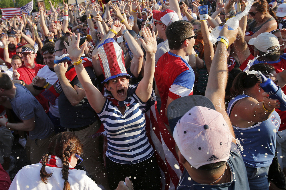 Fans react when the US scores its second goal during the USA vs Portugal World Cup game at Easton Town Center in Columbus, Ohio, on Sunday, June 22, 2014. The game ended in a draw 2-2 in the final seconds of extra time.