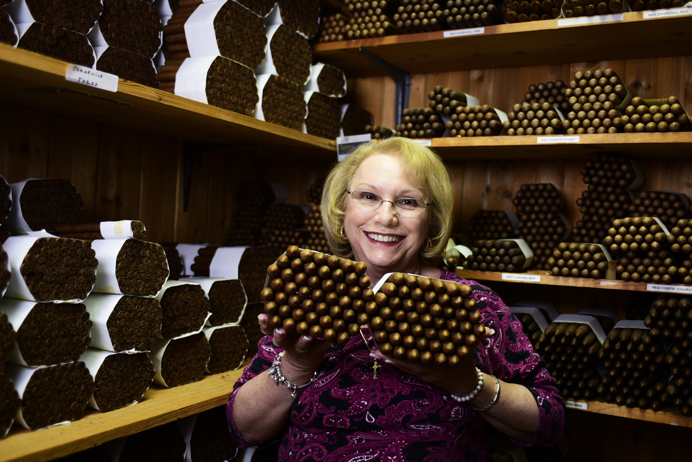El Titan de Bronze owner Sandy Cobas poses in her humidifying room on July 7, 2016, filled with hand rolled cigars. However, new FDA regulations may have an impact on Miami's localcigar producers in the coming months and years.