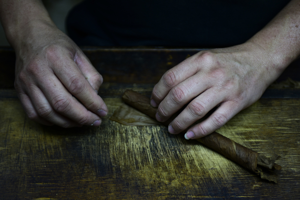 El Titan de Bronze employee Maria Sierra wraps a cigar by hand at El Titan de Bronze located in the community of Little Havana in Miami, Florida.