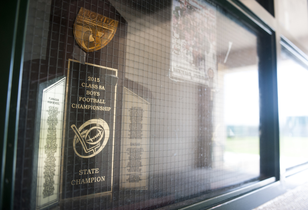 The 2015 state championship trophy sits in the tunnel next to the locker room during the first practice of the high school football season at Flanagan High School on Monday, Aug. 1, 2016. The reigning state champions look to repeat again despite the loss of key players from last year.