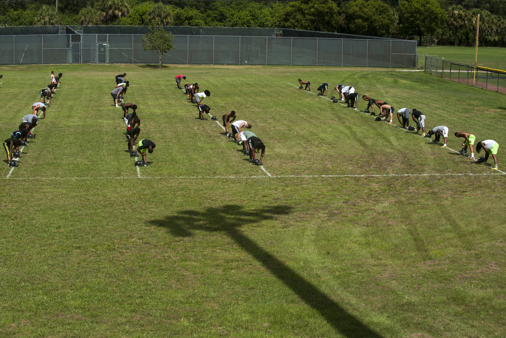 The Flanagan High School football team line up for stretches during the first practice of the high school football season at Flanagan High School on Monday, Aug. 1, 2016. The reigning state champions look to repeat again despite the loss of key players from last year.