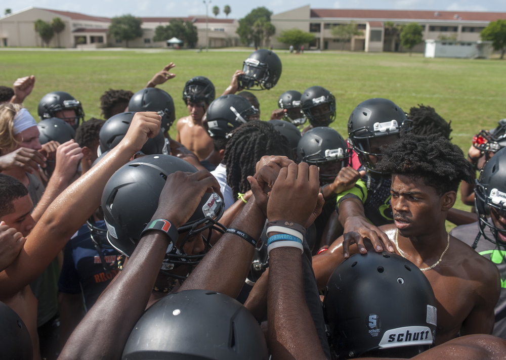 Flanagan high school senior Stanford Samuel III (right) leads in the breaking of practice after conditioning drills during the first practice of the high school football season at Flanagan High School on Monday, Aug. 1, 2016. The reigning state champions look to repeat again despite the loss of key players from last year.