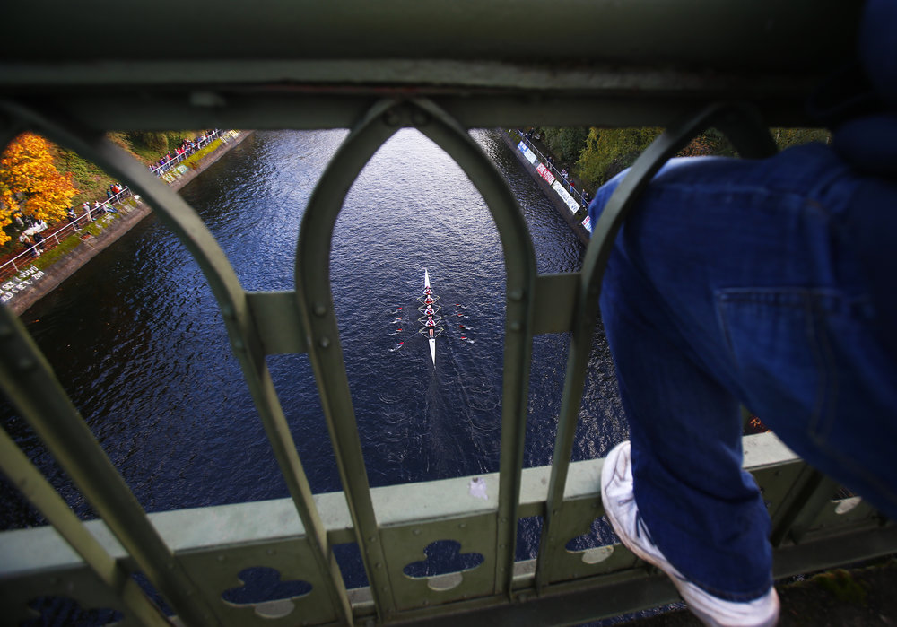 Rowers in the Women's Jr. 4x Coxed division make their way through the Montlake Cut during The Head of the Lake Regatta on Sunday, November 6, 2016. The regatta involves 69 clubs participating in 68 events totaling approximately 2,300 athletes.