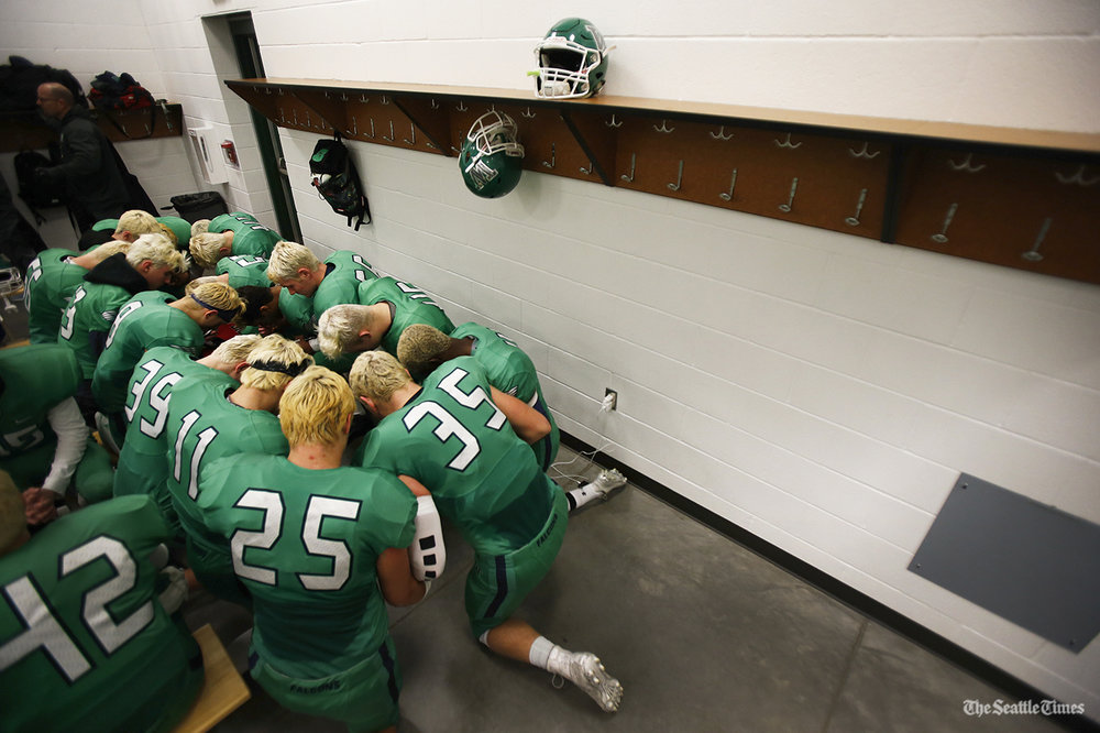 Members of the Woodinville football team huddle up int he locker room prior to their4A state quarterfinal game against Sumner High School at Pop Keeney Stadium in Bothell on Friday, November 18, 2016.