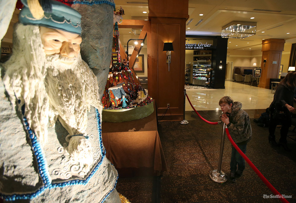 Noah Lamarche, 11, looks up at an almost 7-foot-tall chocolate molded Dumbledore during the 24th annual Gingerbread Village held at the Sheraton Seattle Hotel on Monday, November 21, 2016. Over 1,000 volunteer hours for this event and the displays use an estimated 1,200 lbs. of dough, 800 lbs. of icing, 200 lbs. of white chocolate, 250 lbs. of almond paste and hundreds of pounds of candy. The Village has raised more than $841,000 for the JDRF.