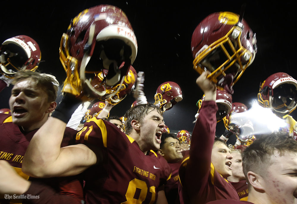 The O'Dea Fighting Irish celebrate their 35-9 win in the State semifinal game against the Meadowdale Mavericks held at Pop Keeney Stadium in Bothell on Saturday, November 26, 2016.