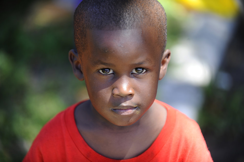 Glenn Towns, 4, poses for a portrait in the Liberty City neighborhood of Miami, Florida, while helping his family build a new community garden.