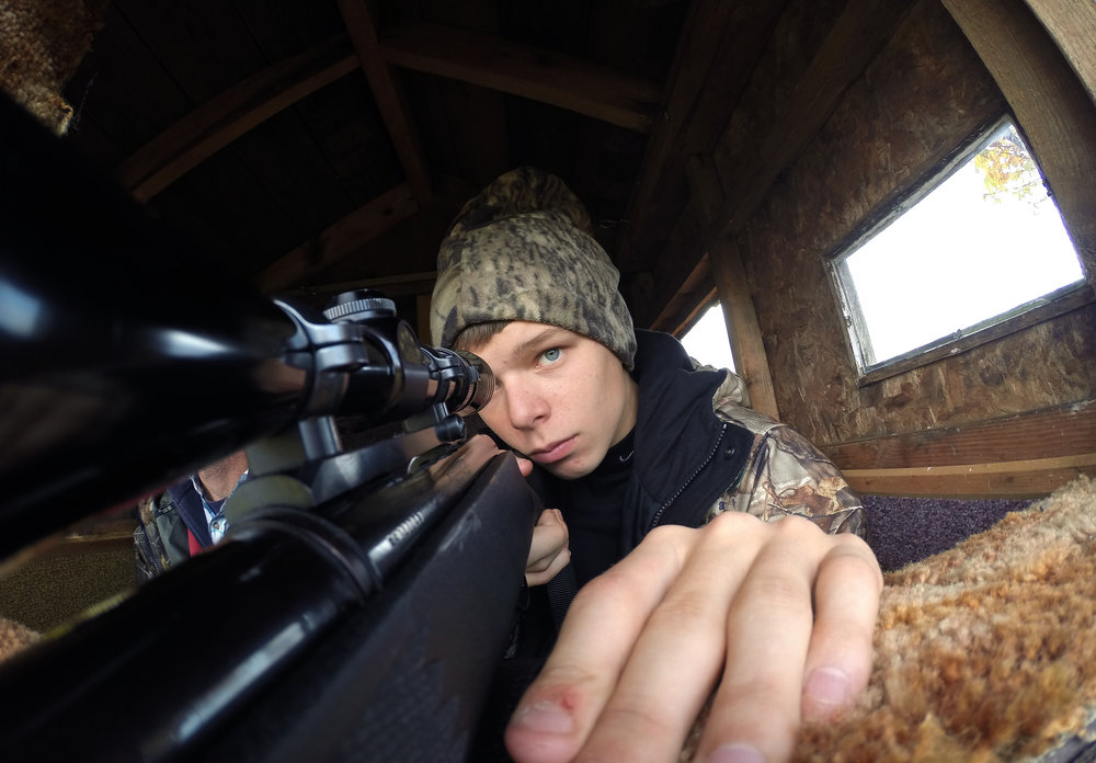 Michael Schult looks through his rifle scope in search of deea while hunting with a friend on his private property located in Jeffersonville, NY. Michaels father taught him everything he knows about hunting nut unfortunately passed away two years prior.