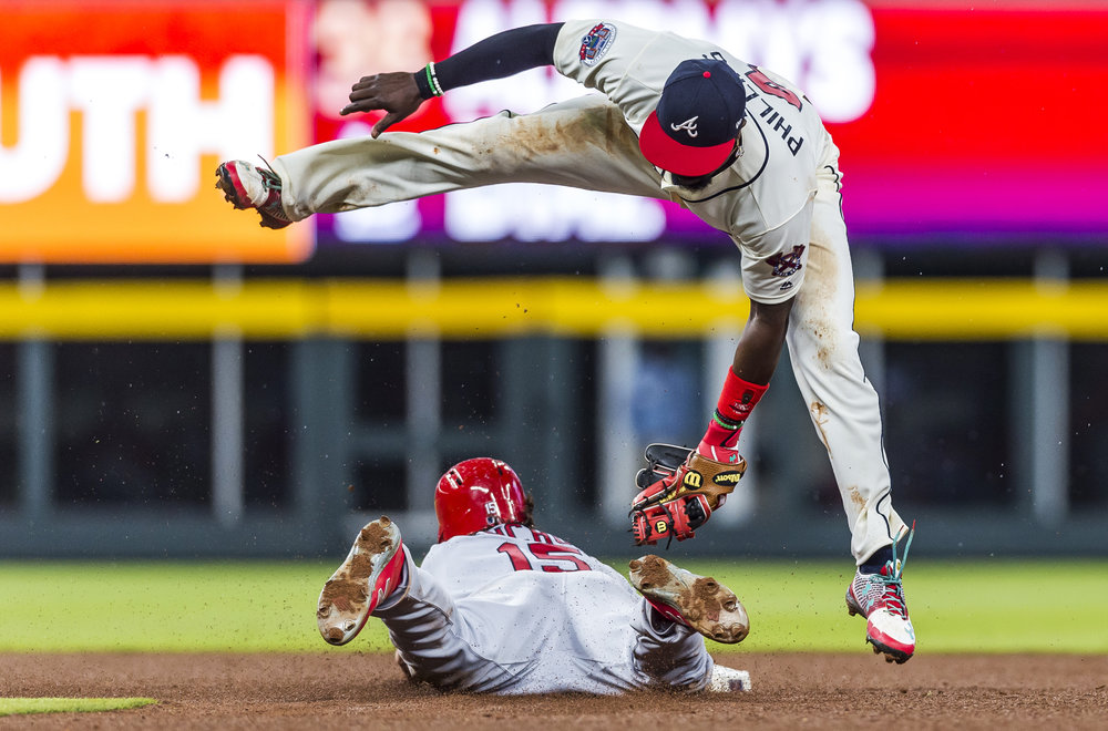 ATLANTA, GA - MAY 06: Brandon Phillips (4) of the Atlanta Braves fields a ball against the Arizona Cardinals at SunTrust Park on May 6, 2017 in Atlanta, Georgia. The Cardinals won the game 5-3.