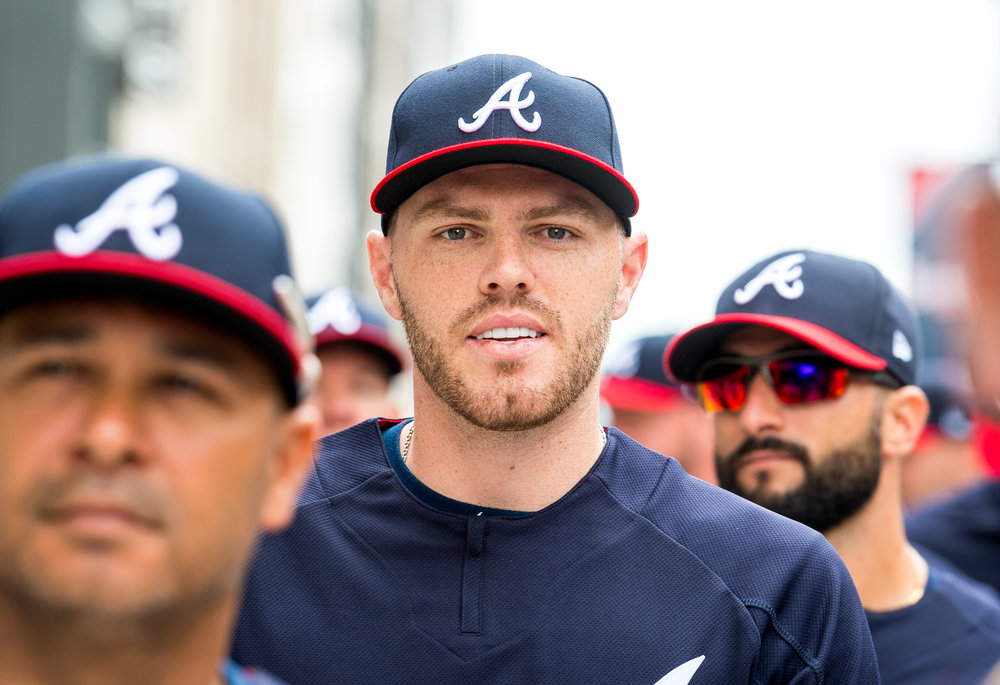 ATLANTA, GA - MARCH 29: Freddie Freeman #5 of the Atlanta Braves walks down The Battery with his teammates in the parade before the game against the Philadelphia Phillies on Opening Day at SunTrust Park on March 29, 2018, in Atlanta, Georgia.