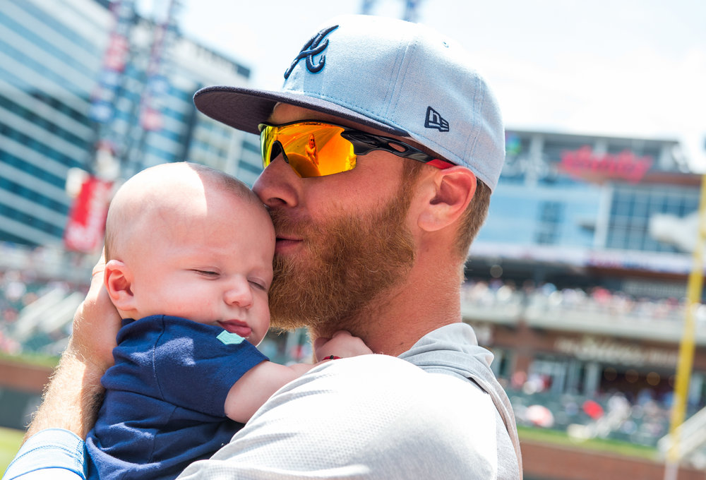 ATLANTA, GA - JUNE 17: Mike Foltynewicz #26 of the Atlanta Braves kisses his baby Jett before the game against the San Diego Padres at SunTrust Park on June 17, 2018, in Atlanta, Georgia. The Braves won 4-1.