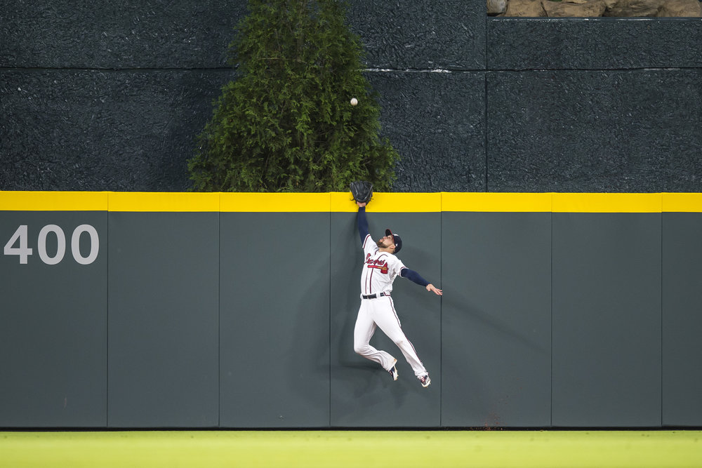 ATLANTA, GA - MAY 05: Ender Inciarte (11) of the Atlanta Braves fields a ball against the Arizona Cardinals at SunTrust Park on May 5, 2017 in Atlanta, Georgia. The Cardinals won the game 10-0.