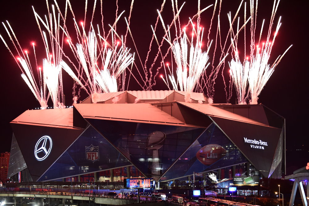 Mercedes-Benz Stadium is lit up by fireworks during the halftime show at Super Bowl LIII in Atlanta, Ga, February 3, 2019.