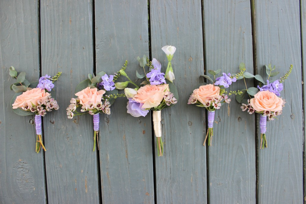 Matching boutonnieres of spray roses, sweet peas and wax flower. The groom stands out in ivory!   Photo by The Floral Cottage