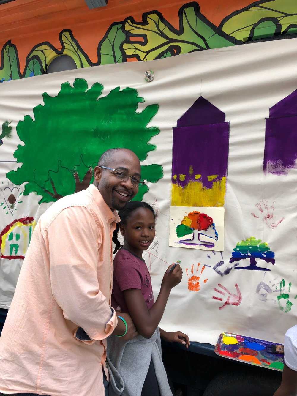 Pictured is newly-elected Council Member Loren Taylor assisting his daughter's fine stencil work.